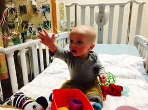 9 days following Open Heart Surgery, Kaden is sitting and reaching for bubbles.